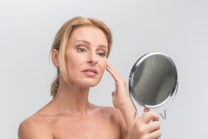 woman-looking-in-hand-mirror